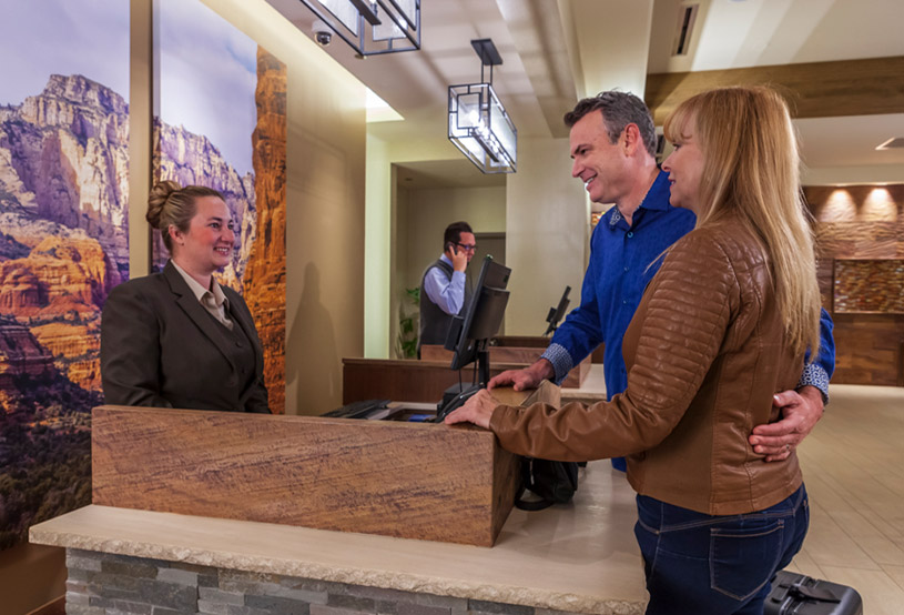 Couple checking into hotel at the receptionist desk