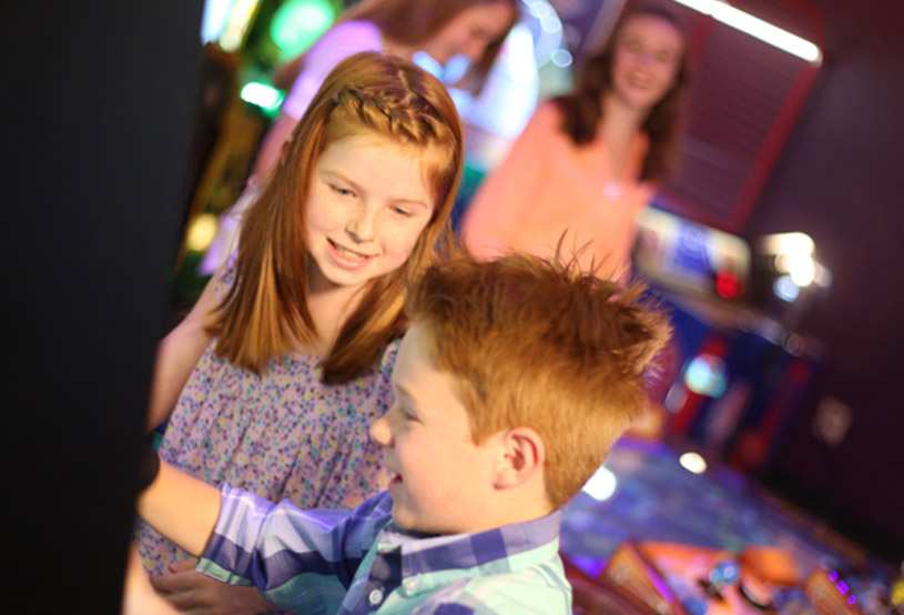 Kids having fun at the arcade